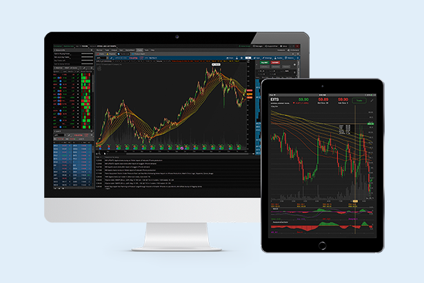 Desktop computer and tablet showing trading platform